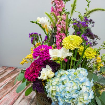 This bright, vintage European-flavored garden flower arrangement is a perfect summer centerpiece.