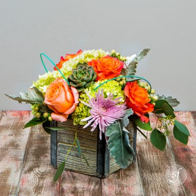 A bright spring arrangement, perfect for small spaces.