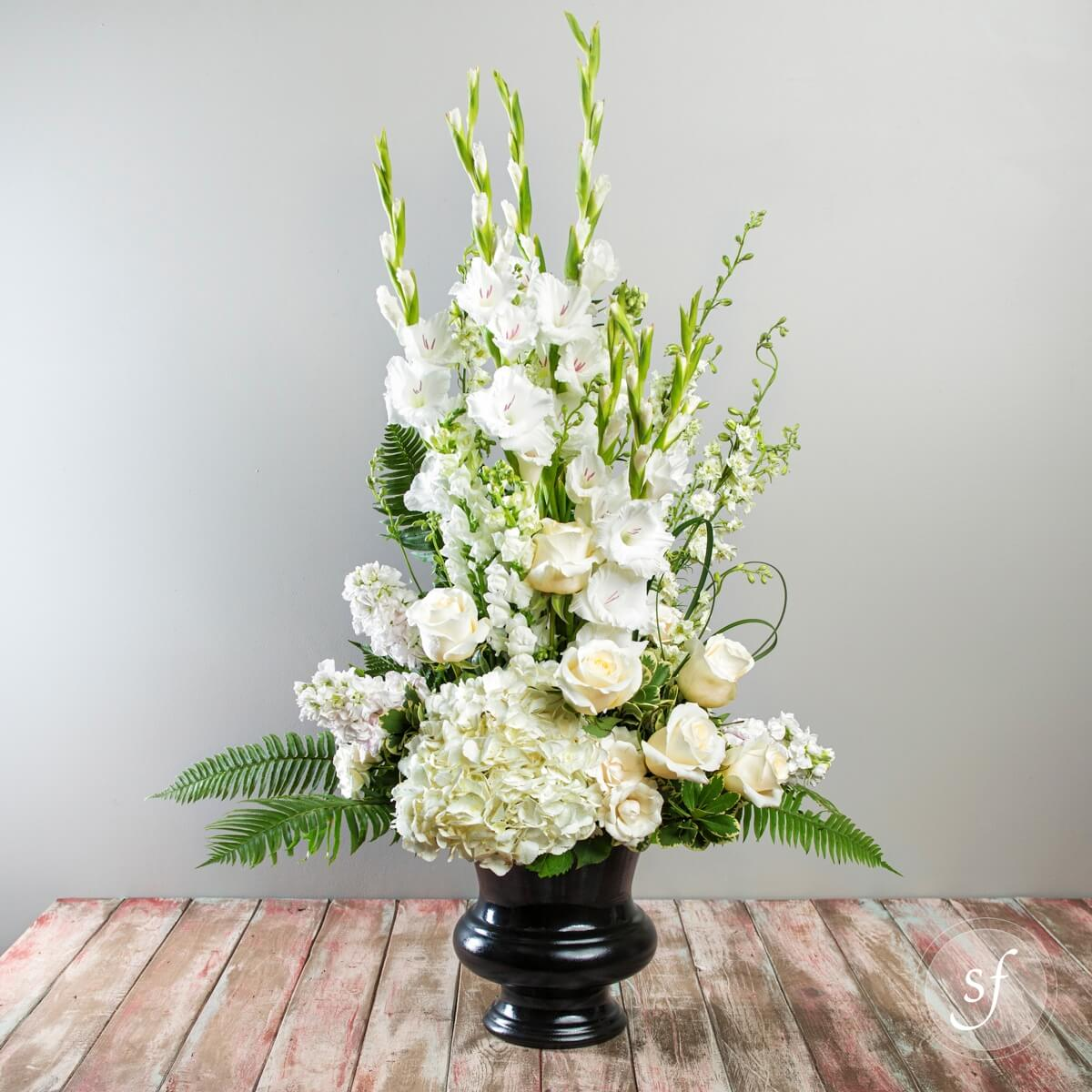 Express Sympathy With This Large And Elegant Funeral Arrangement Featuring White
