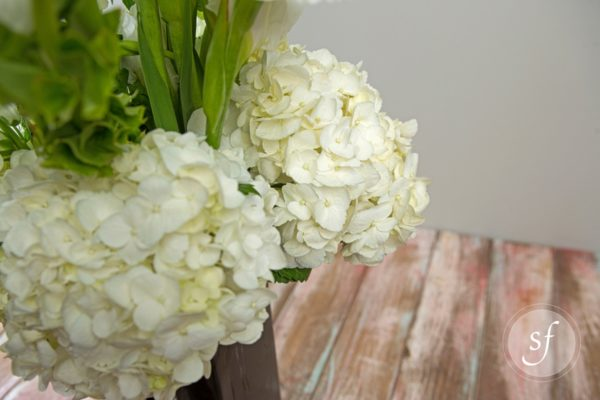 Close up of white hydrangea in elegant and statuesque bereavement arrangement.