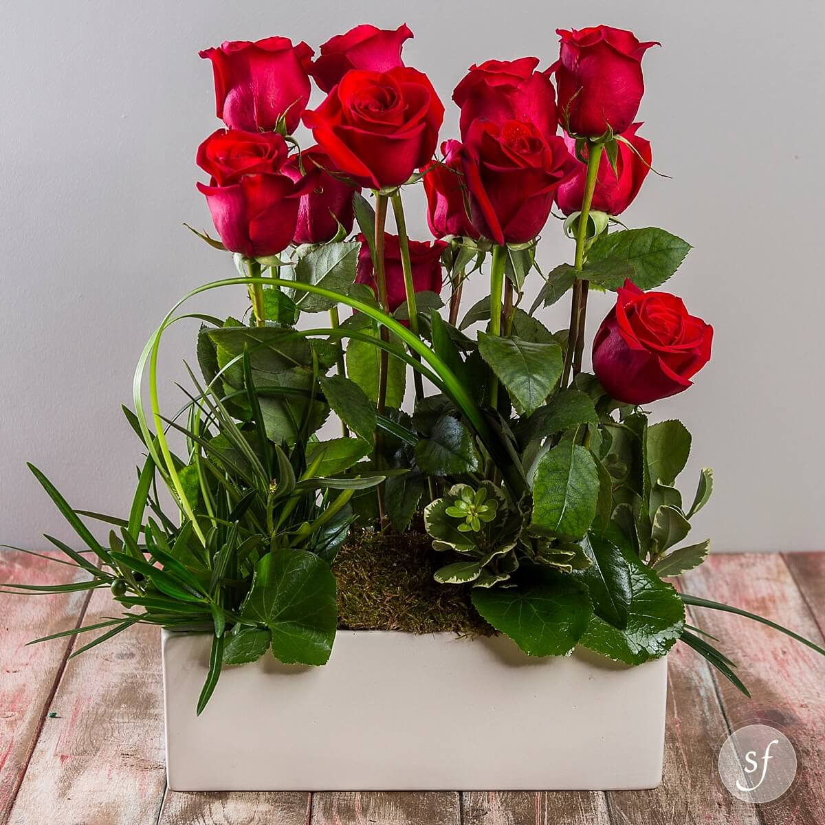 This modern rose centerpiece is a beautiful and elegant gift. Perfect flowers for an anniversary