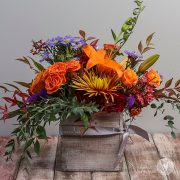 Colorful fall blooms in a rustic box.