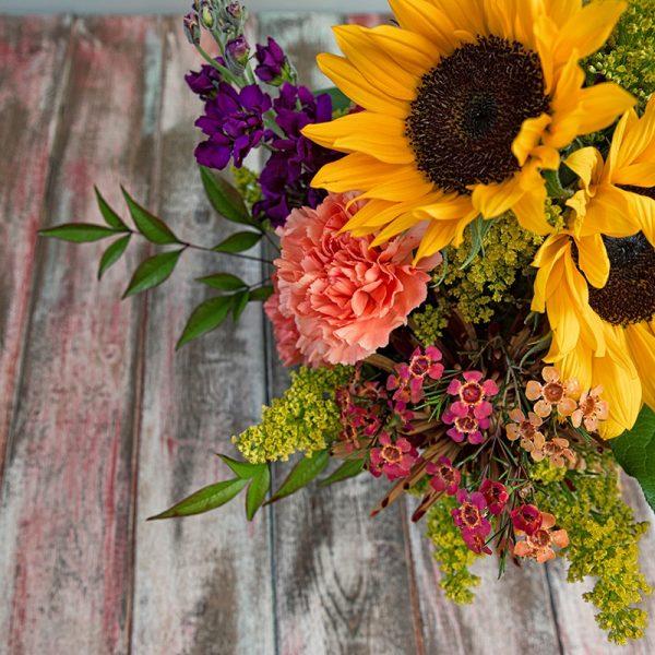 Detail of sunflowers in summer arrangement.