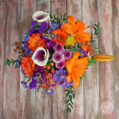 Vibrant orange and purple flower bouquet for fall