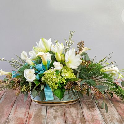 This stunning wintry bouquet is the perfect way to honor a loved one or complement elegant holiday party decor.