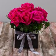 Bright pink pave roses create a modern and petite centerpiece that is perfect for smaller spaces. Designed by the florists at Steve's Floral in Manhattan, Kansas, this affordable flower arrangement is available for same day flower delivery.