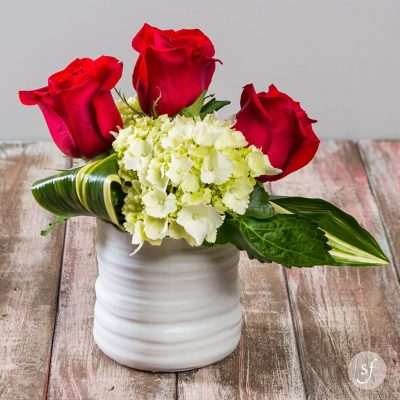 This petite and modern rose arrangement is a perfectly sweet way to let someone know you're thinking about them.