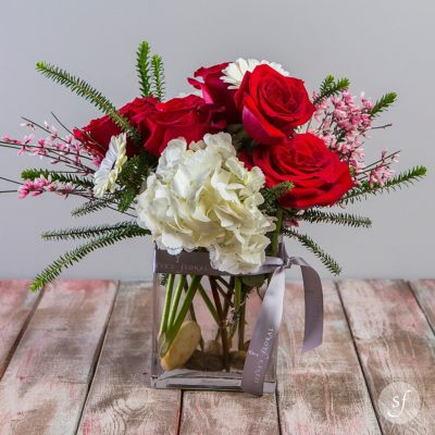 Heart's Desire is a perfect gift for a new Valentine on Valentine's Day. It is a petite romantic arrangement featuring red roses and white hydrangea.