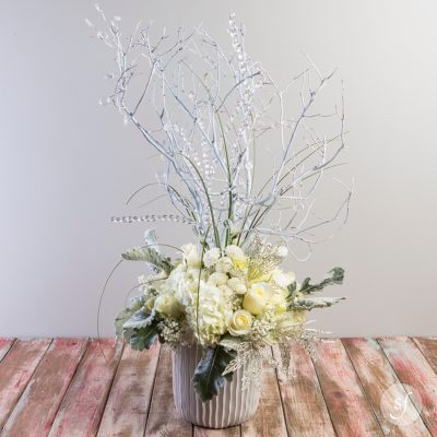 Crystal Serenity features a medley of white flowers and crystal accents. Perfect for a holiday statement piece or as a sympathy arrangement, Crystal Serenity is elegant and breathtaking.