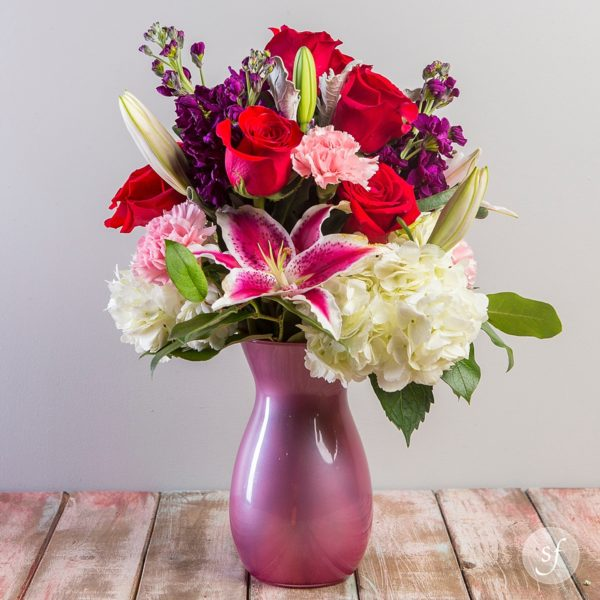 This romantic flower arrangement is sure to bring a smile to your sweetheart's face. These are the perfect flowers for an anniversary, Valentine's Day, Mother's Day, or even to celebrate a new baby girl.