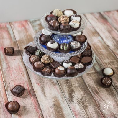 Multi-layered serving tray filled with local, artisan-made chocolates in truffles that were handcrafted in Kansas.