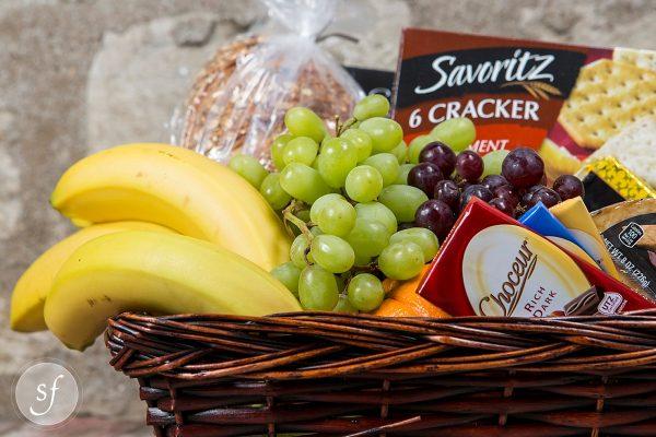 Deluxe gourmet fruit and snack basket