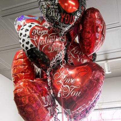 Valentine's day themed mylar balloons that say I love you.